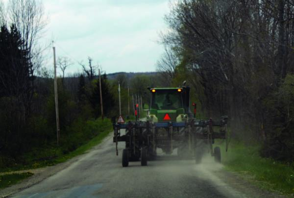 Tractor with slow moving sign on road
